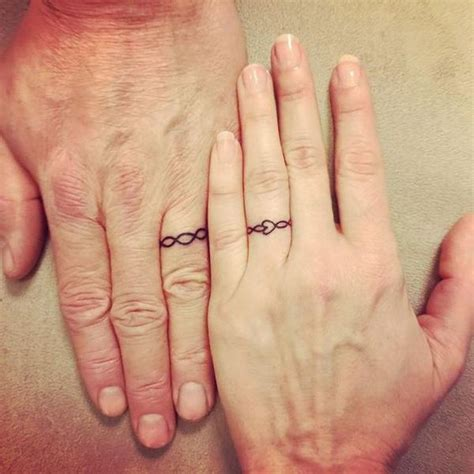 matching ring tattoos for couples best 25 wedding ring tattoos ideas on wedding