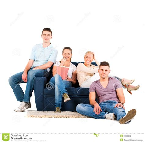people sitting on a couch young people sitting on a sofa smiling stock images