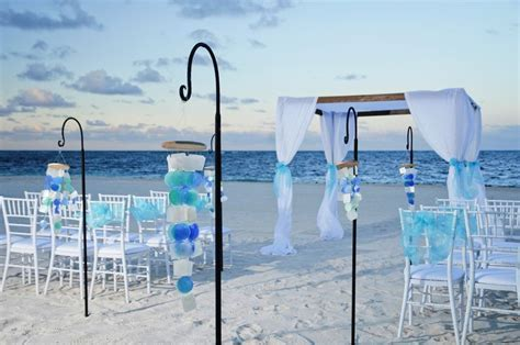 Blue beach wedding setup, hanging decorations and gazebo