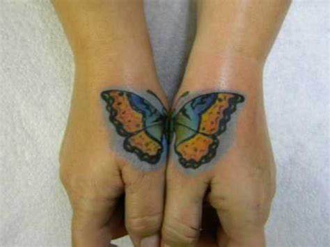 hand tattoo cover up butterfly freehanded cover up