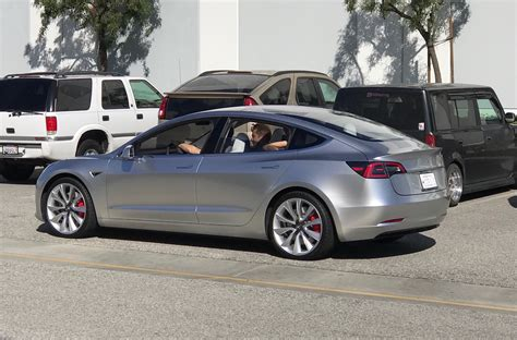 tesla outside tesla model 3 spotted testing along hyperloop track