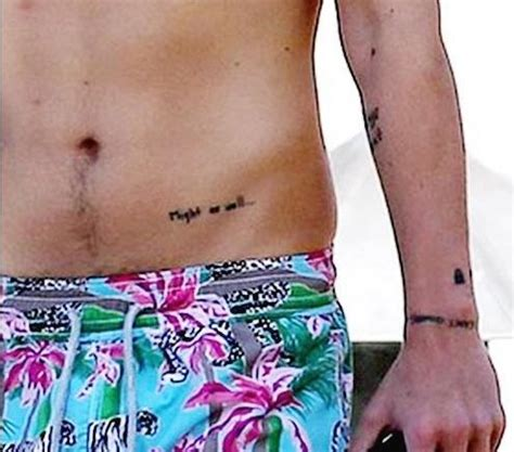 harry styles covers up things i can arm tattoo with new harry styles hip tattoo quot might as well quot plus new shoulder