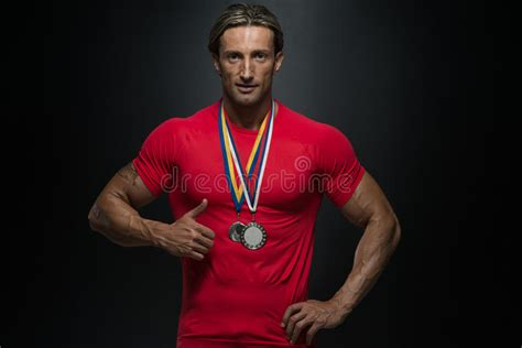 middle age athlete competitor showing  winning medal