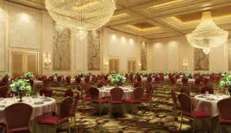 luxury banquet chandeliers and floral arrangements