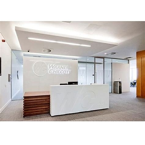 Timber Reception Desk White Solid Surface Counter Reception Desk With Timber Low Level Counter Rd107 Huntoffice Co Uk