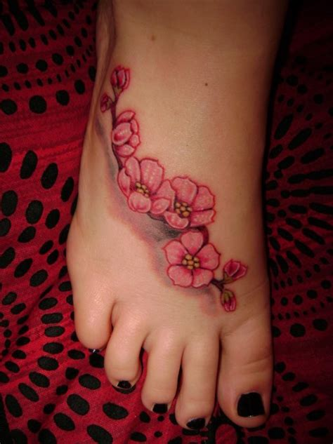 black and white flowers tattoos on right foot
