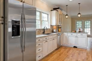 kitchen white cabinets stainless appliances interior