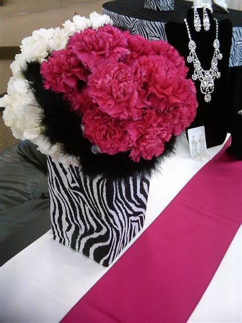 Magenta & white carnations, with black feathers cute
