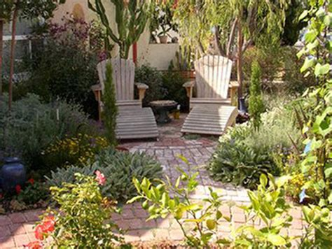 Small Mediterranean Garden Ideas Drought Tolerant Plantings Surrounding A Small Brick Patio Create A Mediterranean Courtyard In