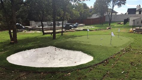 synthetic putting green  sand trap  backyard