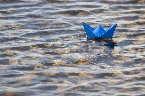 origami boat on water paper boat in water stock photos image 5288613