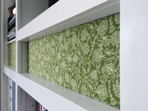 picture of diy patterned fabric bookshelf cover up