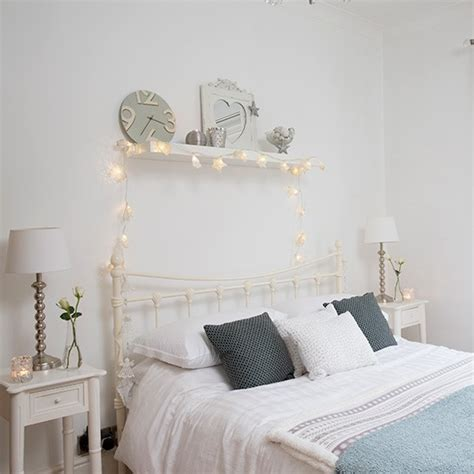 White Bedroom With Metal Bedstead And Fairy Lights White Lights In Bedroom
