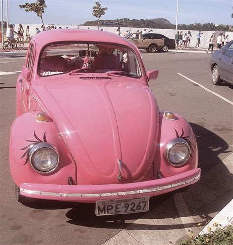 pink volkswagen beetle with eyelashes pink volkswagen beetle with eyelashes