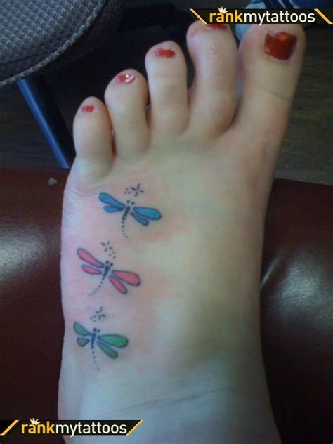 small dragonfly tattoo on foot foot i the colors but i believe mine will