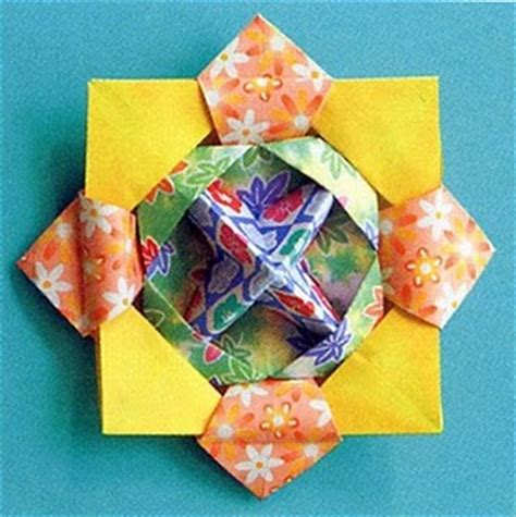 Origami Spinner - origami maniacs origami spinner top