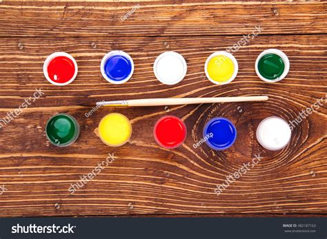 acrylic paint near me acrylic paints jars near brush on stock photo 482187163