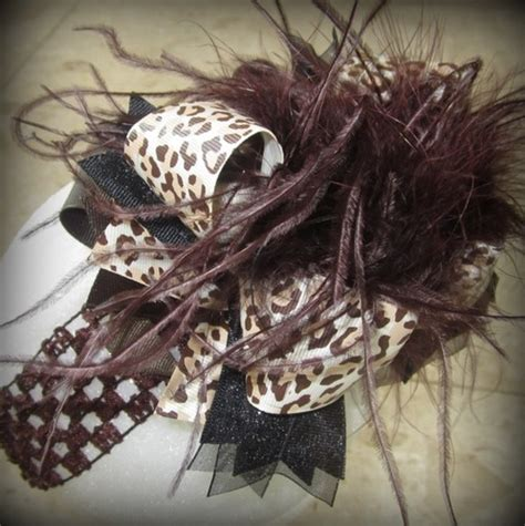 the top peacock hair bow curly ostrich feather center brown leopard the top ostrich feather hair bow