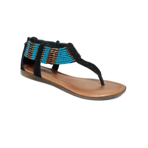 minnetonka sandal lyst minnetonka ibiza flat sandals in black