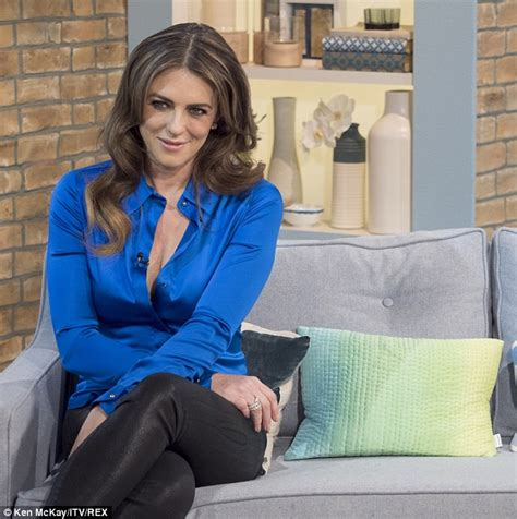 Low Cut Blouse At Work by Elizabeth Hurley Only Just Maintains Modesty As She