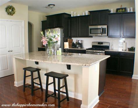 white kitchen tour guest countertops slate backsplash kitchen tour dark cabinets giallo ornamental granite