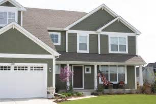 exterior blue craftsman style siding along with