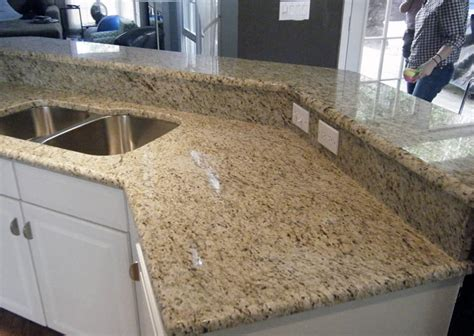 Cream White Kitchen Cabinets by Giallo Ornamental Granite