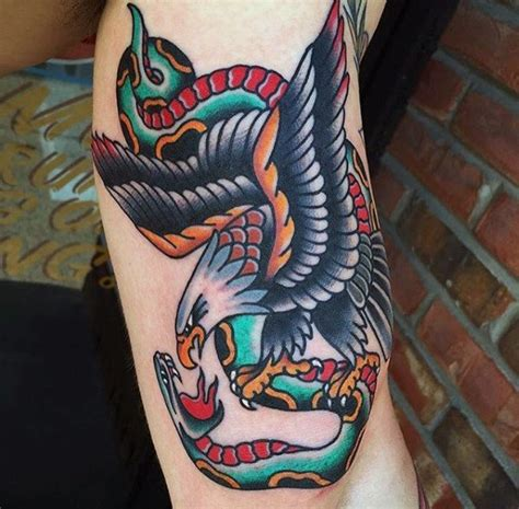 traditional tattoo eagle meaning 70 traditional snake tattoo designs for men slick ink ideas