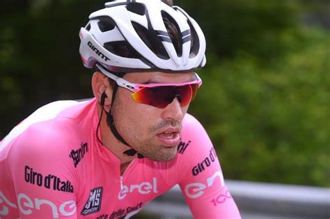 Overall Tom dumoulin climbs to superb win on oropa to extend his overall lead at the giro cycling today