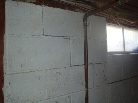 cracks in the joints of a concrete block basement wall