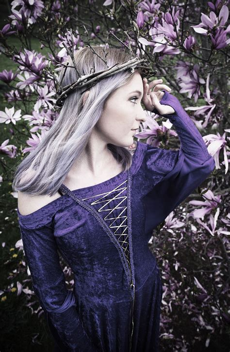 young woman wearing velvet purple dress  twig crown