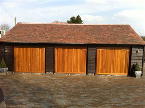 Cedar Clad Garage Doors by Whitford New Build Construction To Bromsgrove