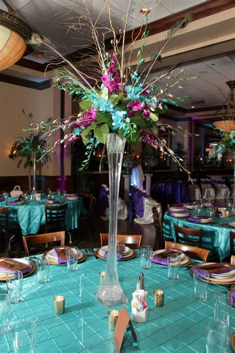 Feather Vases Weddings by Peacock Wedding Centerpiece Eiffel Tower Vase With Orchids Peacock Feathers And Curly Willow