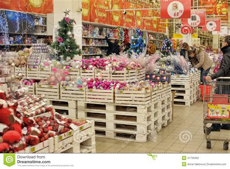 people in the store to buy christmas decorations editorial