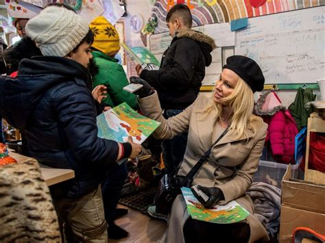 Turned Away By Marines by Visits Migrant C That Turned Away Le Pen