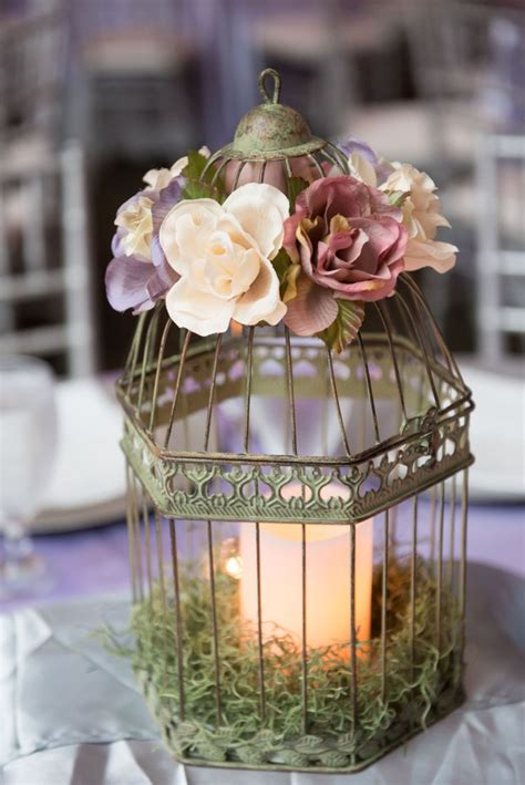 my diy wedding birdcage centerpieces with silk flowers battery operated candles and spanish