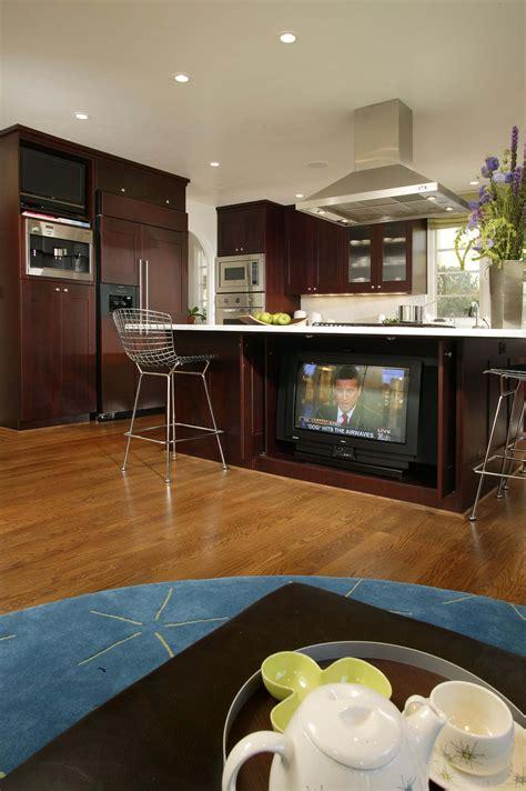 Large, open plan kitchen featuring natural hardwood