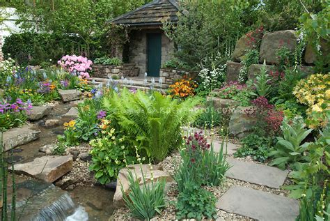 Stone shed & gorgeous flower garden   Plant & Flower Stock