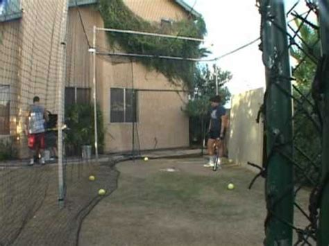 how to build a backyard batting cage batting in my backyard batting cage from the right side