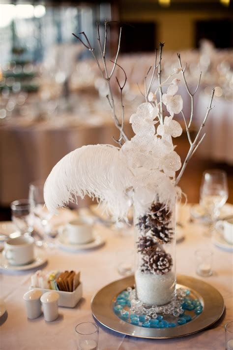 winter wedding table centerpieces 3 get rid of feathers and the charger plate just branches flowers pine cones and snow in the