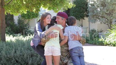 Family Intervened To Help Leave Husband by Soldier Returning Home And Greeted By Family Stock