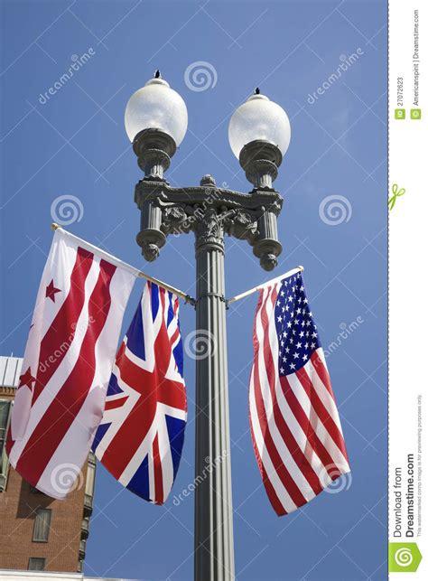 hanging flag on house american flag hanging with union jack british flag next to the white house washington