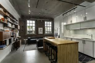 Renovated Loft With Industrial living space and kitchen of the renovated vancouver loft historic loft