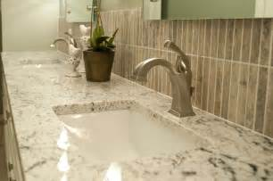Innovative delta dryden in bathroom traditional with white granite