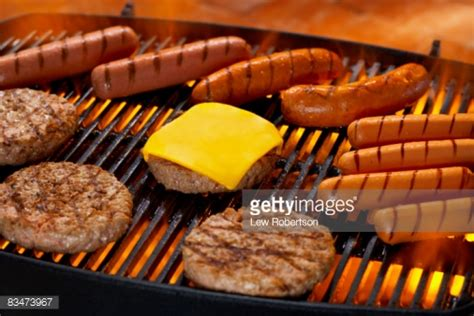 dogs and hamburgers hamburgers and dogs on grill stock photo getty images