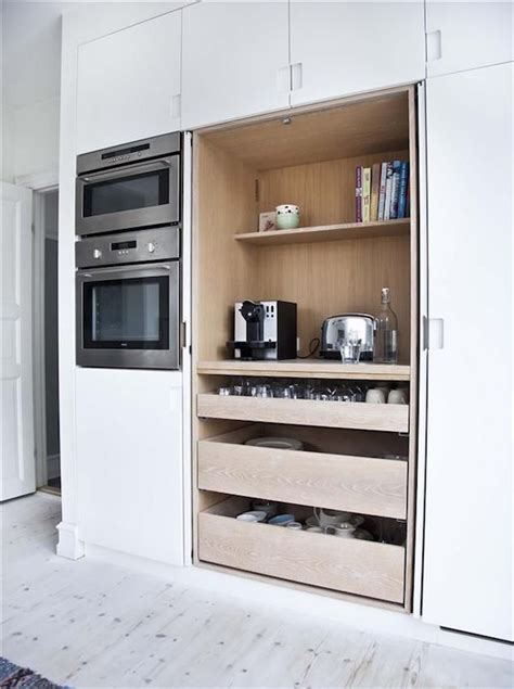 pocket doors to hide kitchen appliances a must in a dream disappearing act 15 minimalist hidden kitchens
