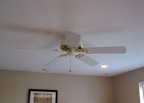 white and gold ceiling fan this thrifty house spray paint helps the family room along