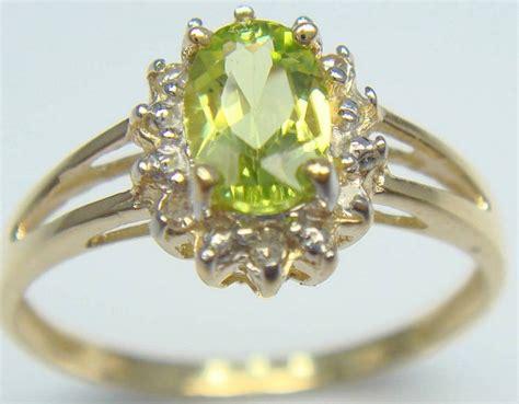 3 95 Ct Peridot Jg gold ring set with 0 46 ct peridot and 6 diamonds 0 13 ct