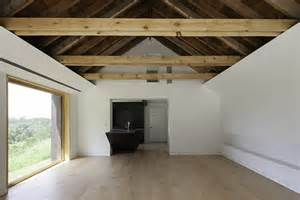 vaulted ceiling with beams renovated home has open vaulted ceiling with exposed beams