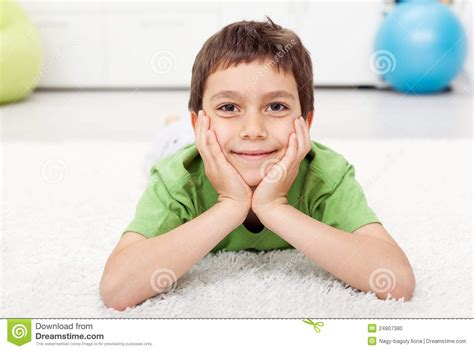 Laying On The Floor by Boy Laying On The Floor Stock Photo Image 24907380